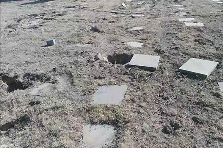 desecrating MEK martyrs' graves