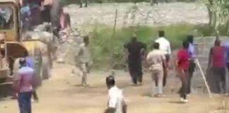 Air Force Guards Attack Protesters