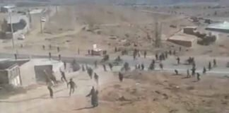 Iran security forces attack landfill protesters