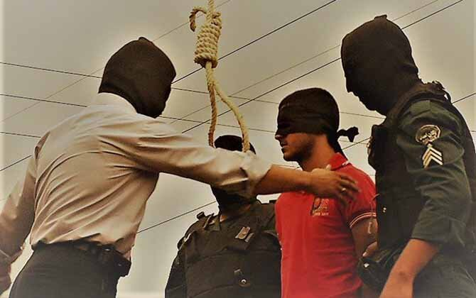 Flanked by masked hangmen, a convict is taking his last breath before being hanged. File photo.